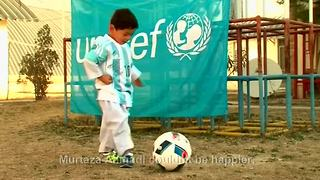 Afghan boy receives message from Messi - Video