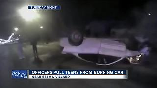 Milwaukee Police save 2 people from burning car - Video