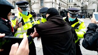 Police FORCE protesters away from 10 Downing Street - Santa's Save Christmas - London - 12/12/20