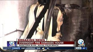 Overnight fire damages Royal Palm Beach home - Video