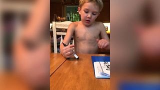Boy Hilariously Fails To Erase Permanent Marker - Video