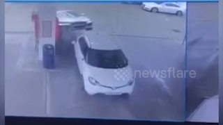 Car mounts another at UK petrol station - Video