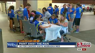 Runners stop cross country trek to paint with cancer patients, caregivers - Video