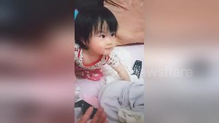 Adorable Taiwanese baby starts crying when mom demands candy back - Video