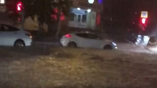 Cars Struggle Through Flooded Streets of Black Sea Town