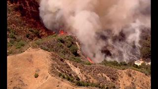 LA County Firefighters fight blaze in Newhall Pass area - Video