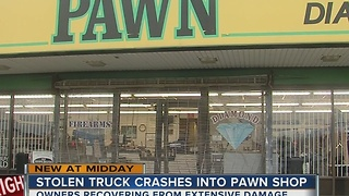 Man crashes stolen truck into pawn shop