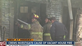 Fire crews investigating a vacant house fire in Sand Springs - Video