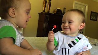Twin Teases Brother With Lollipop - Video