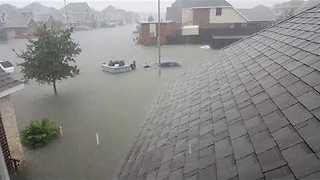Residents of flooded Baytown, Texas, Evacuated on Boats - Video