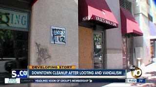 Downtown cleanup after looting and vandalism