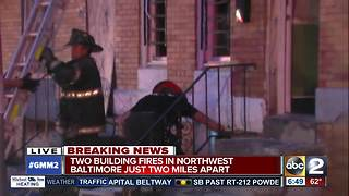 Two building fires two miles apart in Baltimore - Video