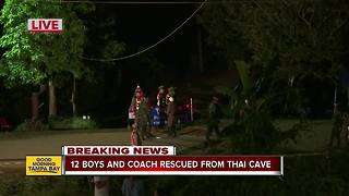 All 12 boys, coach rescued from Thailand cave - Video