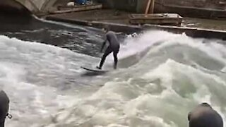 Surfers ride huge waves in Munich canal!