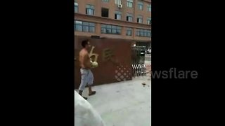 Vendor smashes watermelons outside local government office - Video