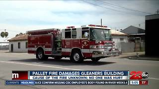 Fire crews put out flames at Gleaners building - Video