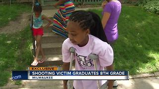 Shooting victim graduates eighth grade - Video