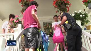 Green Bay Police officers handing out backpacks in community - Video