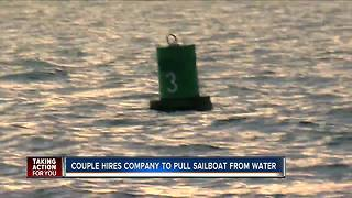 Couple hires company to pull sailboat from water - Video