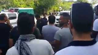Manus Protesters Chant and Gather Outside Closing Compound - Video