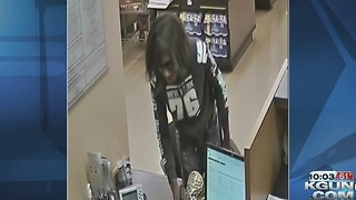 Police looking for wigged armed robbery suspect - Video