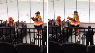 ADORABLE FAN DRESSES UP AS HER FAVOURITE HOCKEY MASCOT AND DANCES WITH HER REAL-LIFE COUNTERPART