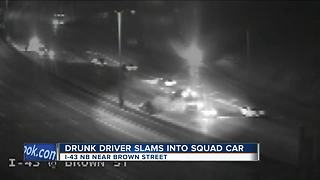 Accused drunk driver smashes into marked squad car - Video