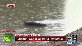 Mesa crews rescue woman from car that went into canal - Video