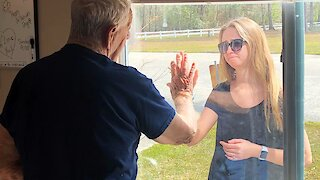 Woman Shows Engagement Ring To Grandfather