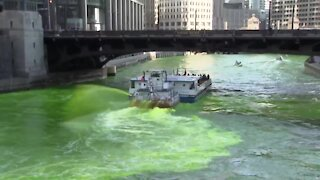 Chicago River dyed green in surprise move by city's mayor
