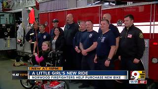 Firefighters help buy little girl's first bike - Video