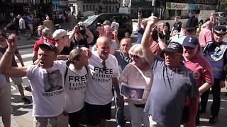 Far-right celebrates after Tommy Robinson contempt conviction is quashed - Video