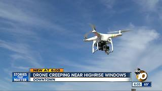 Drone creeping near highrise windows - Video
