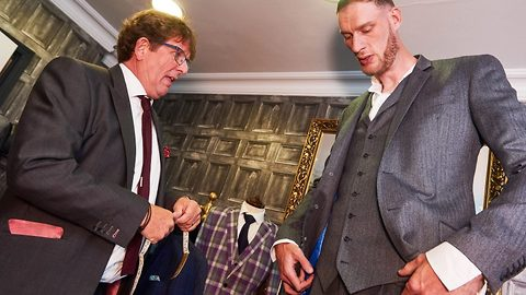 'I have never owned a suit before!': UK's tallest man gets a three piece suit for the first time in his life