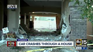 Police: Suspected impaired driver crashes through Phoenix house - Video
