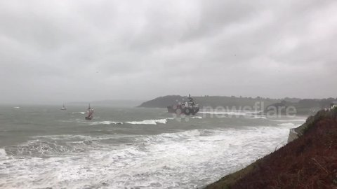 Lifeboat and two tugboats approach grounded Russian tanker off Cornish coast