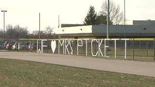 Students show their support for the Pickett family