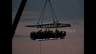 Diners suspended from a crane over South West London - Video