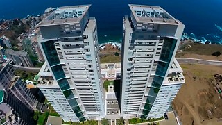 Extreme Wingsuit Stunt: Daredevil Flies Through Buildings - Video