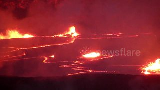 Hawaii lava lake erupts at night - Video