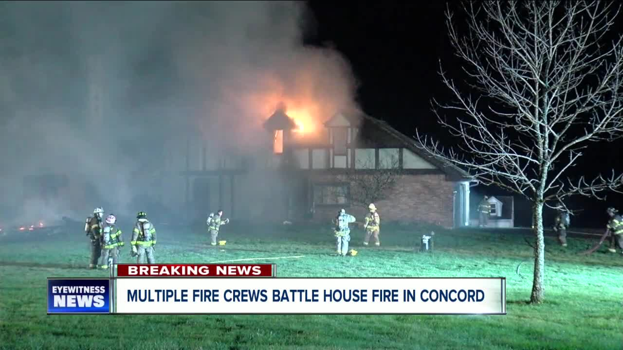 Multiple crews battling house fire in Concord