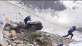 Giant rock almost hits mountain-climbers!