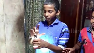 Wonder boy lights LED bulbs without electricity by touching them with his hands - Video
