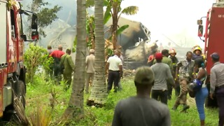 Firefighters, Public Help at Scene of Havana Plane Crash - Video