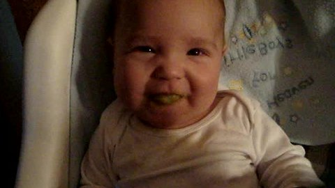 Baby eats peas for the very first time