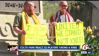 Men protest kneeling during national anthem of football games - Video