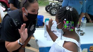 MPD Officers connect with community members over brats