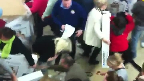 Black Friday shoppers fight over cheap TVs