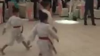 Newlyweds introduced by children's karate display - Video