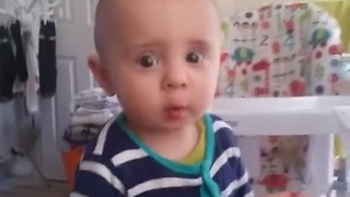 Cute baby saying no to raspberry in a funny way - I don't like it daddy